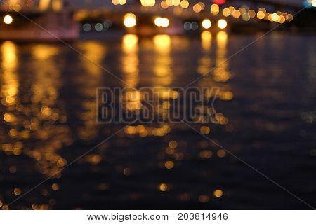 Blury gold Bokeh reflect on the lake background.