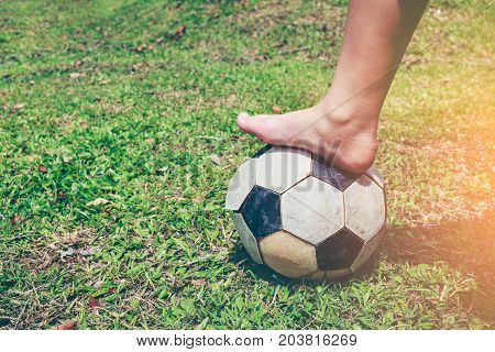 Barefoot Football Player Tread On The Soccer Ball. Healthy Lifestyle Concept.