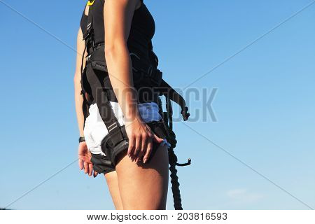 Girl in safety equipment jumping with a rope from a height. Rope Jumping: people in flight from a height. Ropejumping