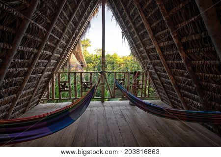 June 6 2017 Puerto Misahualli: hammocks in eco lodge built from bamboo in the jungle