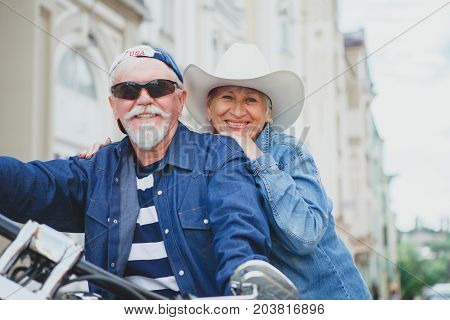 Mature man and woman on a motorcycle. Mature couple riding on a motorcycle.