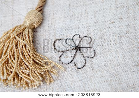 Fishing lure hook. Fishing hooks on a gray background wallpaper.