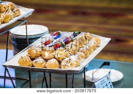 Sugar Flavors And Sweets For Tea Or Coffee Are Located Inside The Auditorium. There Are National Con