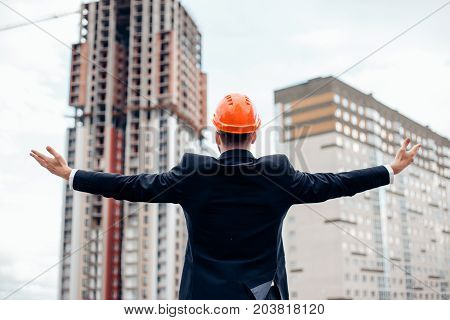 Architect Engineer Dressed In A Suit Raises His Hands A Gesture Of Happiness