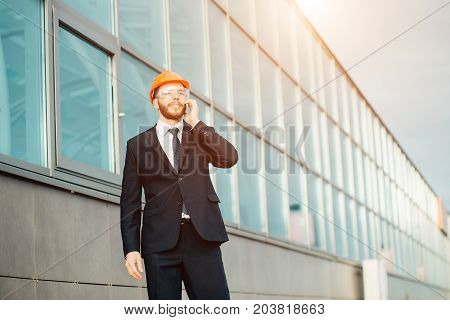 Builder On Site Using Mobile Phone