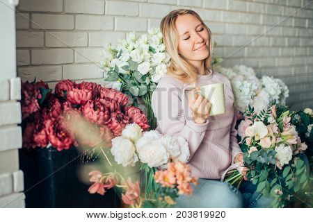 Beautiful Thoughtful Businesswoman Florist With Coffee Cup Sitting In Modern Office
