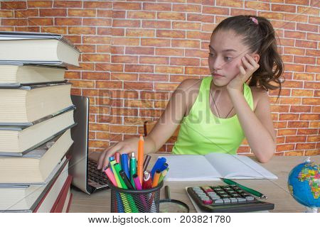 Girl working on his homework. young attractive student Girl studying lessons. Thoughts education creativity concept