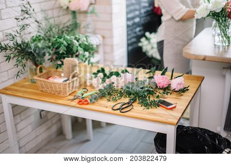 Florist Workplace With Summer Flowers And Accessories