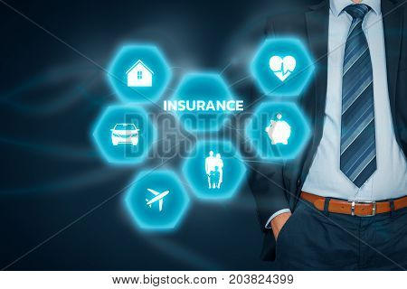 Insurance concept. Businessman with button and insurance icons: real estate insurance, car insurance, travel insurance, family and life insurance, financial insurance and health insurance.