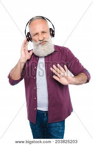 Senior Man Listening Music With Headphones