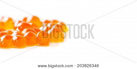 Red caviar salmon fish on white background. macro view shallow depth of field. Copy space.