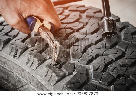 Steel bar puncture car tire, Technician repair car tire