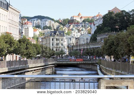 KARLOVY VARY, CZECH REPUBLIC - AUGUST 14: World Spa with many healing springs. View to the center with colonnade and many tourists in the background known Hotel Imperial in Carlsbad Czech Republic on August14 2017