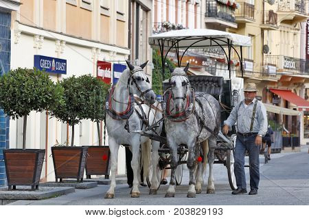 KARLOVY VARY, CZECH REPUBLIC - AUGUST 14: You can explore the world-famous spa and the sights of the city with horse carriage in Carlsbad Czech republic on August 14 2017