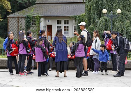 KARLOVY VARY, CZECH REPUBLIC - AUGUST 17: Asian school group gets organizational information before sightseeing tour in Karlovy Vary Czech Republic on August 17 2017