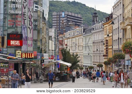 KARLOVY VARY,  CZECH REPUBLIC - AUGUST 17: View in the center of business city with a lot of shops. In background state hotel THERMAL in which take place film festivals in Carlsbad Czech Republic on August 17 2017