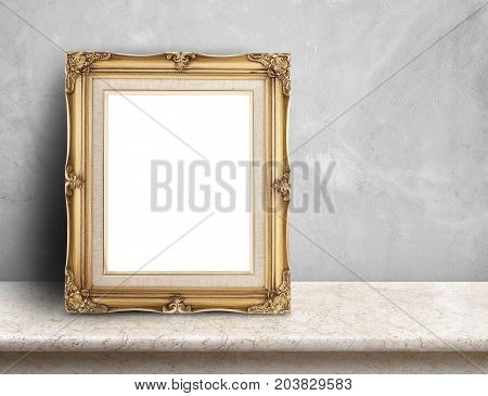 Blank Gold Victorian Picture Frame On Cream Marble Table At Grey Concrete Wall,template Mock Up For