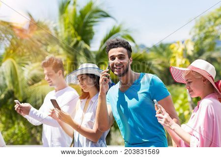 Social Media Communication: Group Of Young People Chatting And Making Phone Call Through Internet Outdoors Mix Race Men And Women Messaging