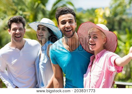 Cheerful Group Of People Making Selfie Photo Portrait Happy Smiling Mix Race Man And Woman Making Self Picture Over Palm Trees
