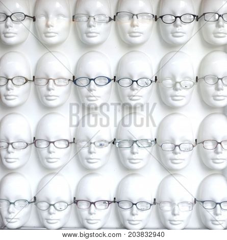 plastic faces in a row with glasses
