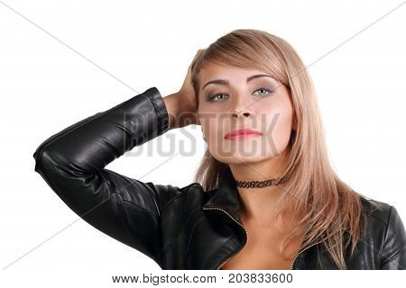 Young blonde in leather jacket isolated on white background close up