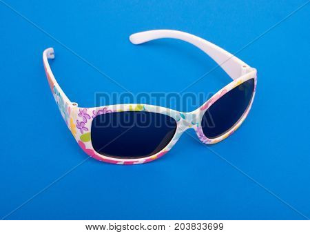 Fashion Summer Plastic Sunglasses On Blue Background For Kids.