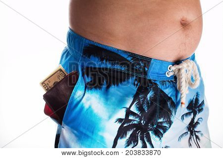 Careless person on holidays. Smart phone and wallet with cash visible in pocket of shorts