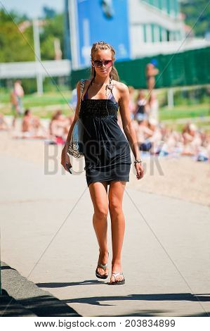 Woman In Swimwear And Dress Walk Around Ada Ciganlija Lake