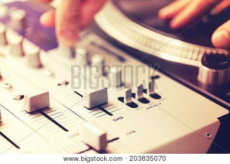 closeup of dj vinyl turntable mixing controller