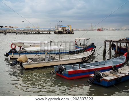 Penang Malaysia - April 24 2017: Motorized Boats boat docking at Clan Jetty or water villages which are homes to various Chinese clan in George town Penang Malaysia.