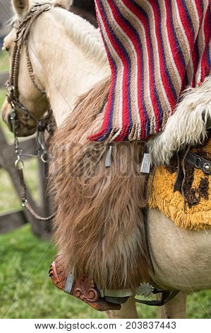 June 3 2017 Machachi Ecuador: closeup traditional chaps and poncho cowboy wear in the Andes