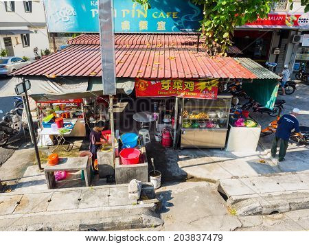 Penang Malaysia - April 24 2017: Local food stall selling various Chinese and local foods at the roadside of Penang street which is quite common in Penang Malaysia