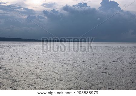 A Sea Landscape With A Lighted Sea And A Dark Sky