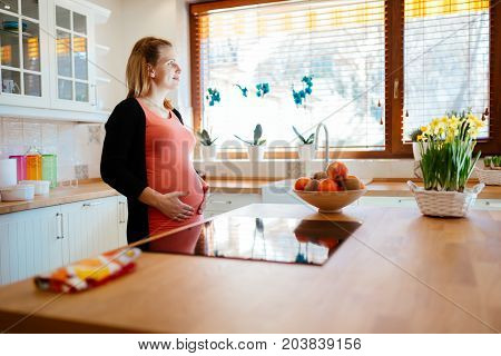 Beautiful pregnant woman ki kitchen anticipating baby