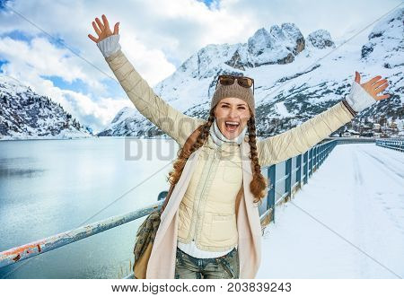 Happy Traveller Woman In Winter Outdoors Rejoicing