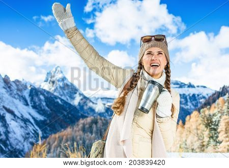 Woman With Thermos Travel Mug In Winter Outdoors Rejoicing
