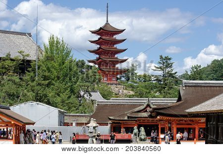 MIYAJIMA JAPAN - AUGUST 21 2015: Torists and Five-storied Pagoda (Gojunoto) at Miyajima island. Japan