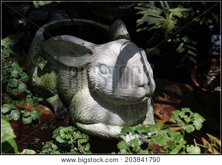 Gypsum Hare Of A Hare In Foliage