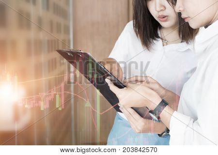 Business woman read a paper chart for a report business consulting concept.