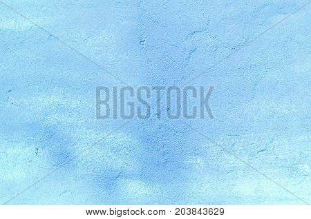 Background of a blue stucco coated and painted exterior rough cast of cement and concrete wall texture decorative coating