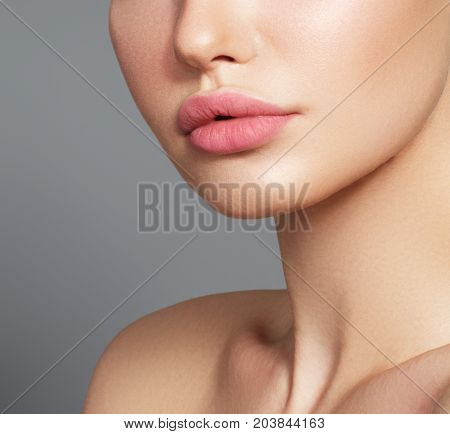 Sexy Plump Full Lips. Close-up Face Detail. Perfect Natural Lip Makeup. Close Up Photo With Beautifu