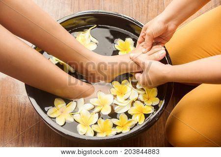 Feet massage in the spa salon, close up