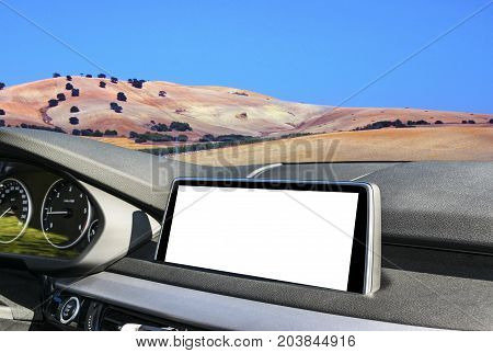 White Screen system display for GPS Navigation and Multimedia as automotive technology in car. white copy space of touch screen. Modern car dashboard empty space for text. Blank empty white screen. Outdoor concept mountain background