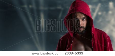 Young man portrait in hooded sweatshirt lights