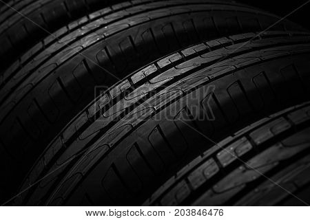 Tire stack on background. Selective focus.Wheel Pattern