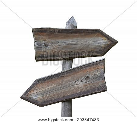 Old vintage road signpost with two wooden planks blank copy space arrows different directions left down and right isolated on white low angle side view