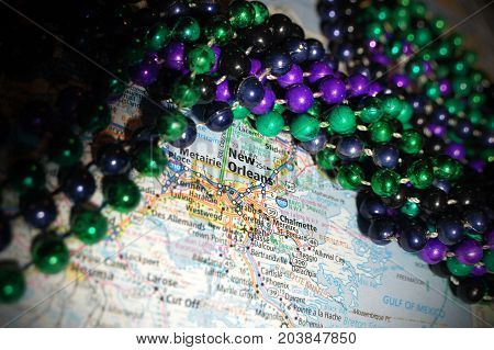 Macro Gras beads pictured with a map of New Orleans, Louisiana.