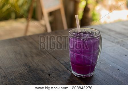 Butterfly pea with lime juice on wood table