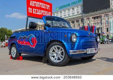 Donetsk Ukraine - August 27 2017: Townspeople watching a retro car on the Lenin Square during the celebration of the city's day