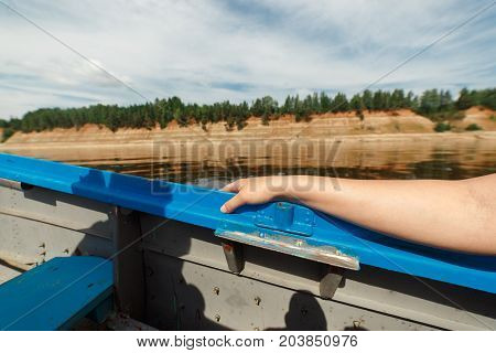 Boat moving at high speed on a beautiful Northern Dvina river in taiga forest, Russia, Arkhangesk region. Shot from inside the boat.